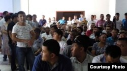 Kazakhs at a courthouse in Aqtau await verdicts in a case concerning riots in the town of Shetpe late last year.