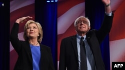 Hillary Clinton (left) and Bernie Sanders appear at the Democratic Party debate on January 17.