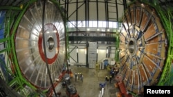 Overview of the first elements of the huge magnet of the CMS (Compact Muon Solenoid) experimental site at CERN. (file photo)