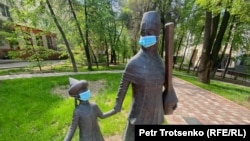 Kazakhstan. Urban sculptures in medical masks. Almaty 21 April 2020