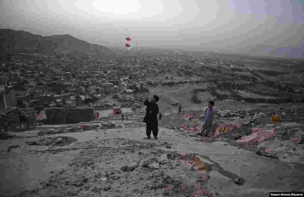 Hazara boys fly a kite on a hill above Quetta. In recent years a surge in sectarian killings targeting the ethnic Hazara minority has led Pakistan's security forces to seal off some sections of Quetta -- the capital of the restive Balochistan region -- with walls and checkpoints.