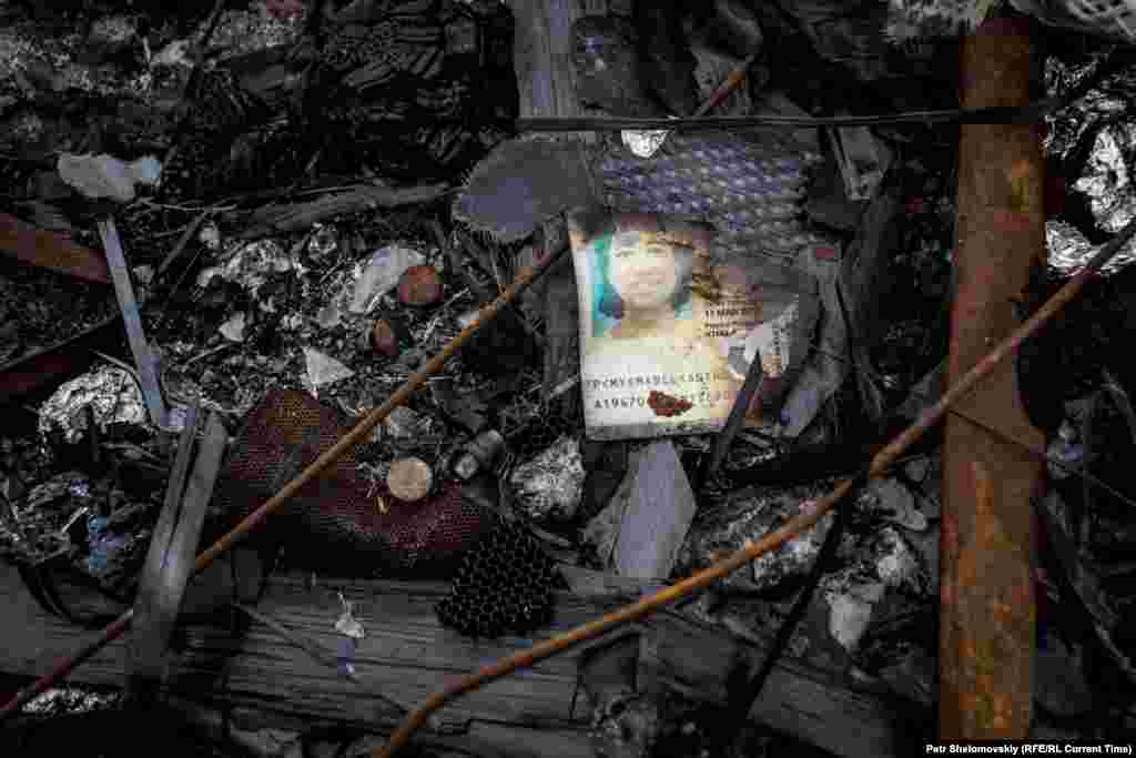 The charred passport of Mabel Anthonysamy Soosai from Malaysia is seen among the debris on April 1, 2015.