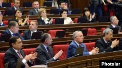 Armenia - Vahram Baghdasarian (L) and other deputies from the ruling Republican Party applaud during a parliament session, Yerevan, 21Apr2015.