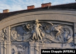 A crumbling facade from a residential building constructed in 1905. The dragon-wrangling hero overlooks Budapest's City Park.
