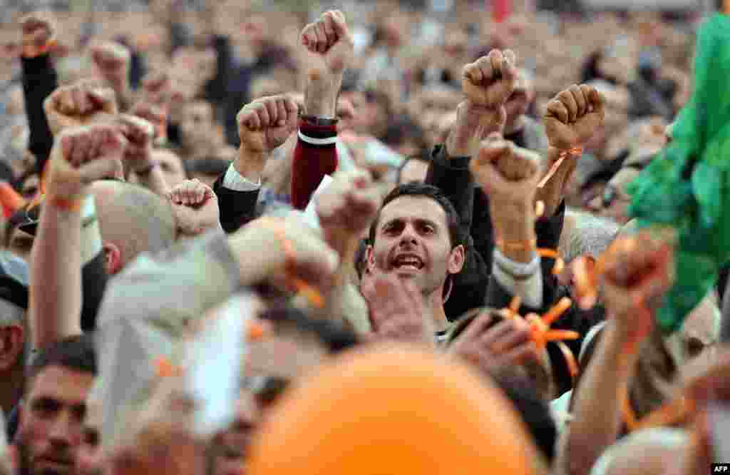 Supporters of opposition leader Raffi Hovannisian rally against President Serzh Sarkisian's victory in elections in Yerevan.