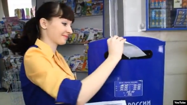 A still from the video by Kira Sheveleva, Russian Post worker in Bely Yar, for an employee-of-the-year contest.