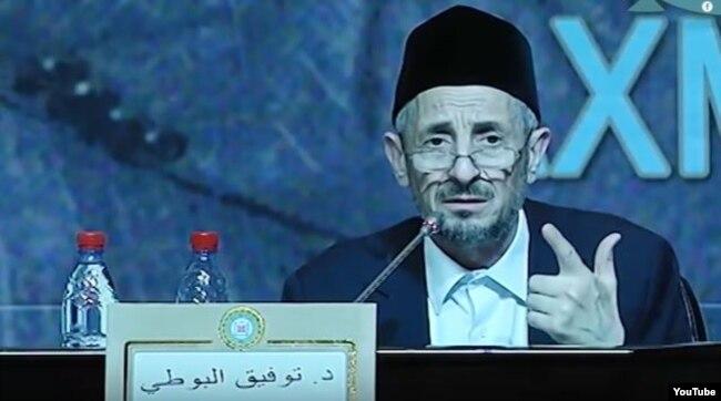 Тауфик аль-Бути во время Исламской конференции в Грозном