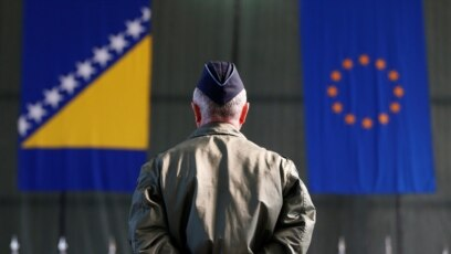 Bosnia-Herzegovina -- A member of European Forces (EUFOR) stands in front of the Bosnia and Herzegovina and European Union flags during Change of Command Ceremony in Sarajevo, March 28, 2017