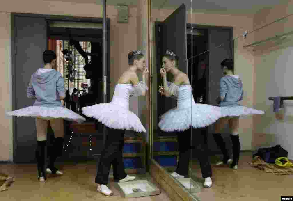 "Contestants prepare backstage before their performance during the ""Grand Prix of Siberia"" international ballet competition, held as part of the 3rd International Forum ""Ballet of the XXI Century"" at the State Opera and Ballet Theatre in Krasnoyarsk, Russia. About 50 ballet dancers from nine countries including Japan, Italy, Germany, Turkey, and Bulgaria took part in the competition judged by a jury headed by the well-known Russian choreographer Yuri Grigorovich. (Reuters/Ilya Naymushin)"
