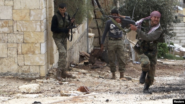 A member of the Free Syrian Army fires at a sniper as he runs for cover during clashes with pro-government forces in Harem in the Idlib Governorate on October 25.