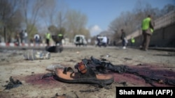 \A sandal is seen laying on the ground along a road at the site of a suicide bombing attack in Kabul on March 21.