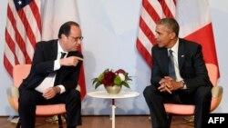 Президент США Барак Обама и президент Франции Франсуа Олланд во время саммита G7 в замке Эльмау в Баварии, июнь 2015 года