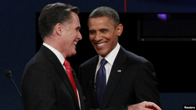 U.S. President Barack Obama (right) and Republican presidential nominee Mitt Romney share a laugh at the end of the first presidential debate.