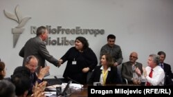 RFE/RL News Director Jay Tolson congratulates Khadija Ismayilova of RFE/RL's Azeri Service on her award for one of the five best stories of 2011. Ismayilova's story on public corruption in Azerbaijan led to changes in government policy.