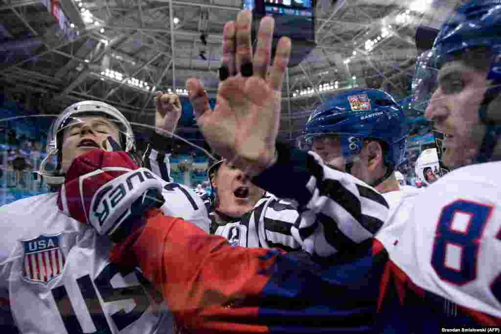 Ice Hockey: John Mccarthy of U.S. is pinned against the glass after receiving a penalty during the men's quarterfinals playoffs ice hockey match between Czech Republic the United States during the Pyeongchang 2018 Winter Olympic Games at the Gangneung Hockey Centre in Gangneung on February 21, 2018.
