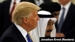 U.S. President Donald Trump (L) and Saudi Arabia's King Salman bin Abdulaziz Al Saud arrive for a signing ceremony at the Royal Court in Riyadh, Saudi Arabia May 20, 2017.