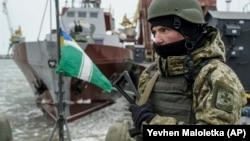 A Ukrainian serviceman stands on board a Coast Guard ship in the Sea of Azov. (file photo)