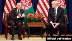 U.S. President Donald Trump (left) with Afghan President Ashraf Ghani in New York on September 21.