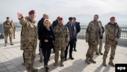 FILE: German Defense Minister Ursula von der Leyen (2-L) takes a tour of the Camp Marmal in Mazar-e Sharif in December 2015.