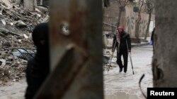 Սիրիա - Մարտական գործողությունների հետևանքով ավերակների վերածված շենքեր Դամասկոսի Դումա արվարձանում, փետրվար, 2015թ․