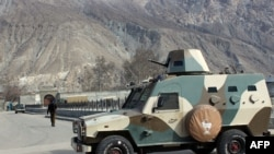A police armored vehicle is parked outside the jail in Gilgit on February 27.