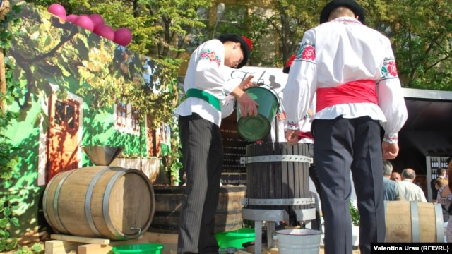 Moldovans preparing to celebrate an event called National Wine Day in October 2012.