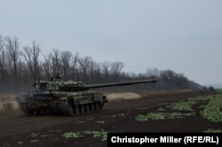 Ukrainian tanks rumble back to their base after recent training exercises in eastern Ukraine.