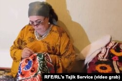 Sherova makes different types of traditional Tajik dresses. (file photo)