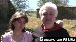 Armenia - Opposition activist Sarkis Hatspanian is pictured with his daughter after being released from Yerevan's Vartashen prison, 9June2011.