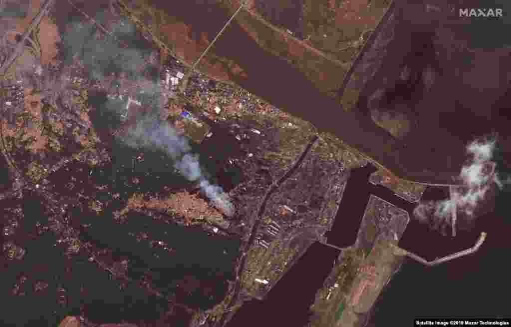 JAPAN -- Satellite image shows a harbor in Sendai on March 12, 2011 (after the tsunami of 2011)