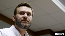 """Aleksei Navalny welcomed the ruling, saying in a statement that """"the time will come when we can obtain justice in a Russian court, and not only in the ECHR."""""""