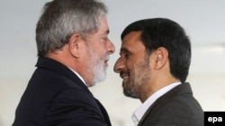 Brazilian President Luis Inacio Lula da Silva (left) greets his Iranian counterpart, Mahmud Ahmadinejad, at the Itamaraty Palace in Brasilia.