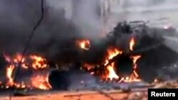 Танк урадавых войскаў, зьнішчаны паўстанцамі. Хомс, Сырыя, 12.01.2012