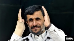 "Mahmud Ahmadinejad addresses a crowd in the city of Isfahan to chants of ""Death to Israel"" and ""Death to America."""