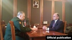 Armenia - Defense Minister Seyran Ohanian (R) and Russian First Deputy Defense Minister Arkady Bakhin, meet in Gyumri to discuss a deadly shooting spree attributed to a Russian soldier,13Jan2015.