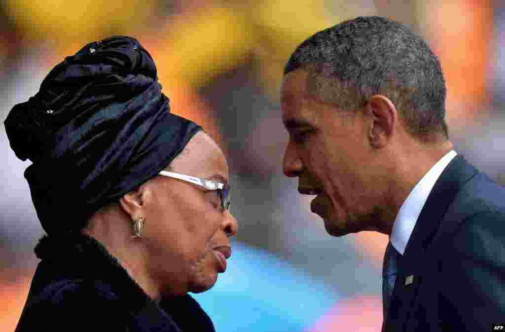 Obama pays his respects to Graca Machel, Mandela's third wife.