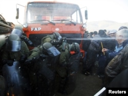 Kosovo Force (KFOR) troops employ tear gas against protesters trying to prevent the barricades from being dismantled in Jagnjenica near Zubin Potok on October 20.