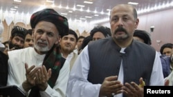 Hashmat Karzai (R) with Afghan presidential candidate Ashraf Ghani during a campaign event in Kandahar on June 6, 2014.