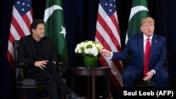 U.S. President Donald Trump (R) and Pakistani Prime Minister Imran Khan hold a meeting on the sidelines of the UN General Assembly in New York, September 23, 2019