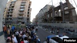 Armenia - Activists demonstrate outside a 19th century building (R) slated for demolition, Yerevan, 10Jun2014.