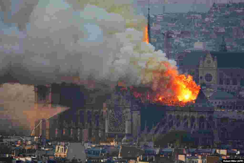Smoke and flames spew from Notre Dame Cathedral on April 15, 2019.