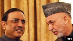"Afghan President Hamid Karzai (right), pictured meeting with his Pakistani counterpart Asif Ali Zardari, says the two countries ""have a new relationship."""