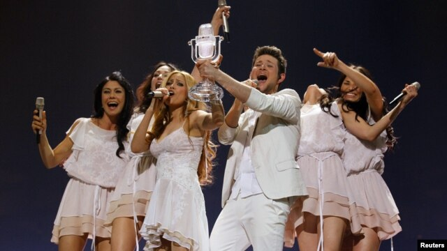 Ell and Nikki of Azerbaijan celebrate on stage after winning the Eurovision Song Contest final in Duesseldorf in May 2011.