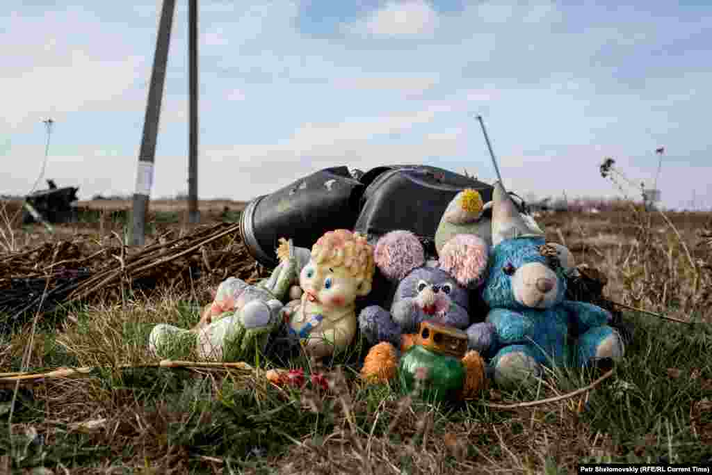 Toys left by local residents in memory of dozens of children who were among the victims.