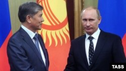 Almazbek Atambaev (left) with Russian Prime Minister Vladimir Putin in 2010