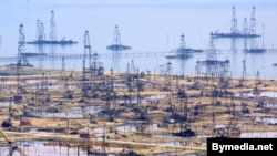 Oil derricks on the shore of the Caspian Sea just outside the Azerbaijani capital, Baku.