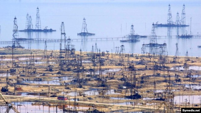 Oil derricks on the shore of the Caspian Sea just outside the Azerbaijani capital, Baku.