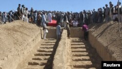 FILE: Graves prepared for the burial of civilians killed by insurgents at Mirza Olang village, in the northern Sar-e Pul province in August.