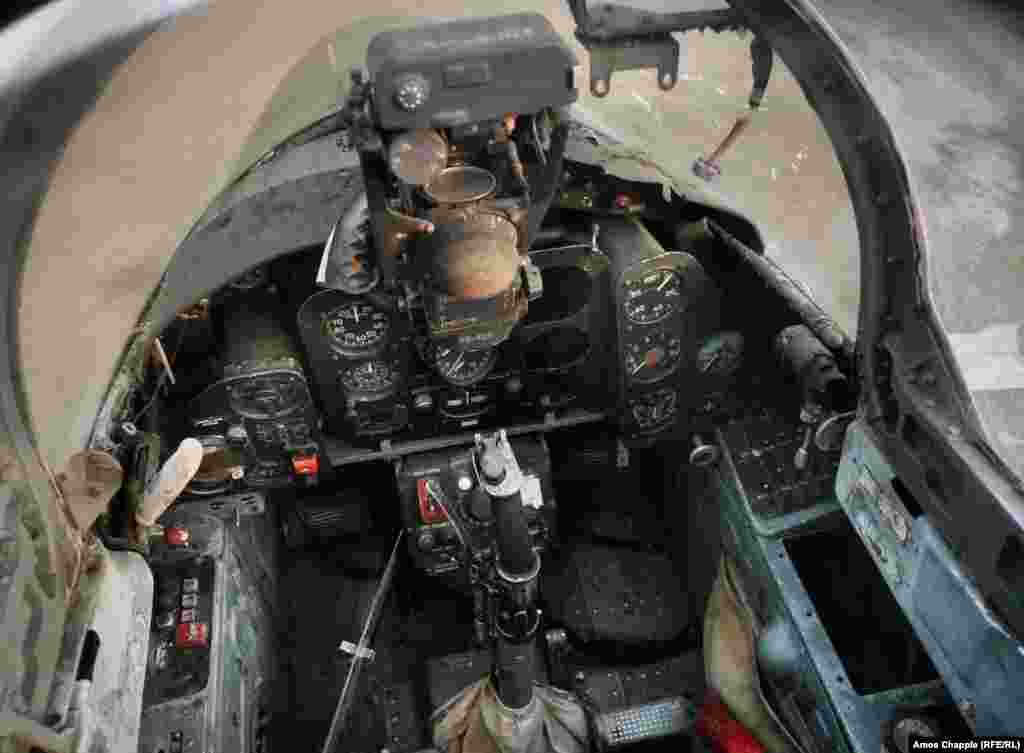 The inside of a Dolphin cockpit. The jets, made by a Czechoslovak company, were designed to be rugged and reliable, and the base's security chief says some of the planes will be able to be refurbished back to flying condition.