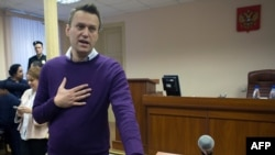 Russian anticorruption blogger Aleksei Navalny gestures during a court hearing in Kirov on December 5.